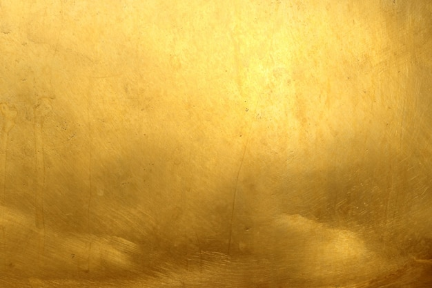 Блестящий желтый лист темной золотой фольги текстуры