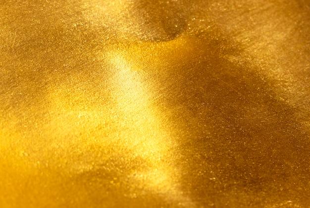 Shiny yellow leaf gold foil texture Premium Photo
