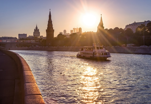 The ship is sailing along the moscow river near the walls of the moscow kremlin