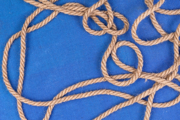 Ship rope on blue surface