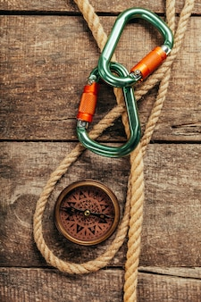 Ship ropes and compass on wood
