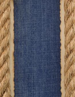 Корабельные канаты на текстуре джинсов