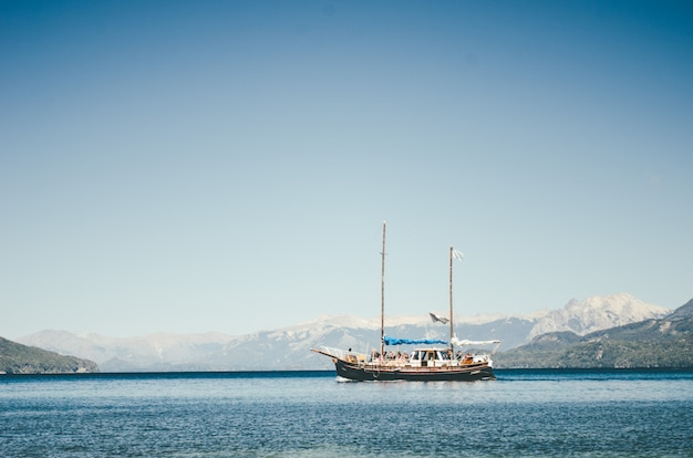 Ship sailing in lake in the city of bariloche, argentina