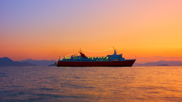 Ship in the sea at sunset  - seascape. long exposition. the ship is a bit blurred in motion!