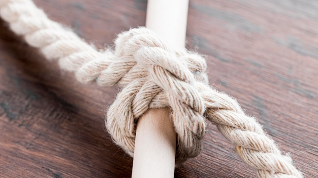 Ship white ropes knot tied on a bar