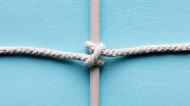 Ship white ropes surrounding a bar