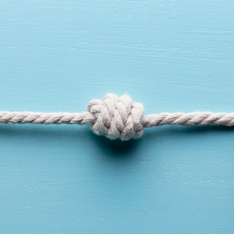 Ship white ropes with knot front view