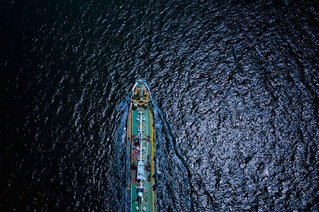 Shipping loading oil tanker service import export international transportation business open sea at night