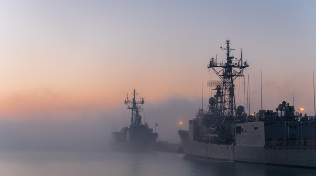 Ships in a naval base with fog