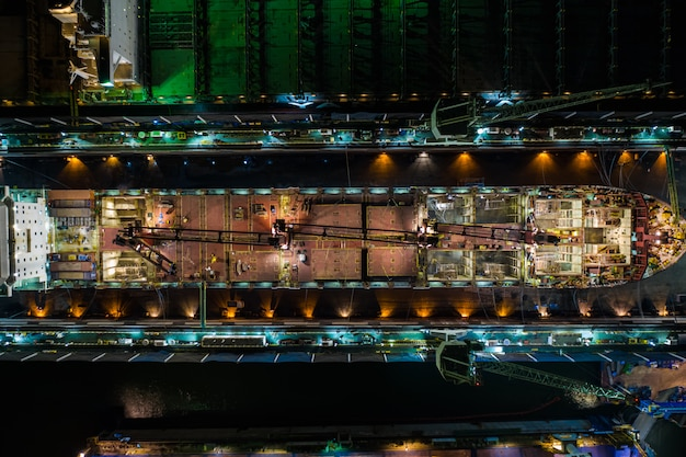 Shipyard industry large on the sea at night in thailand aerial view