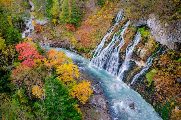 Shirahige waterfall in fall and autumn season, hokkaido, japan