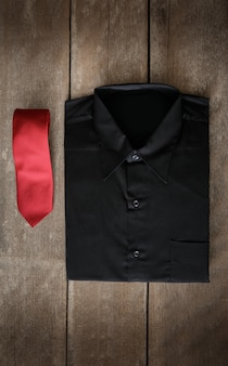 Shirt and neckties on wooden background