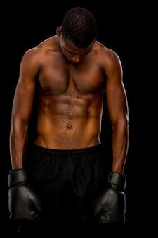 Shirtless boxer over black background