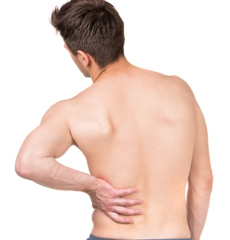Shirtless man touching his back
