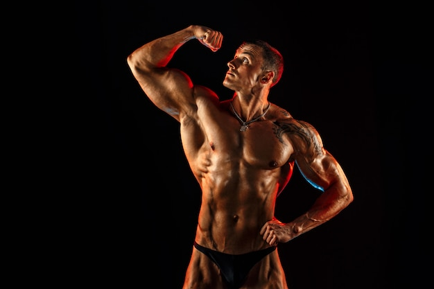 Shirtless man with muscular topless body holding arm up isolated.