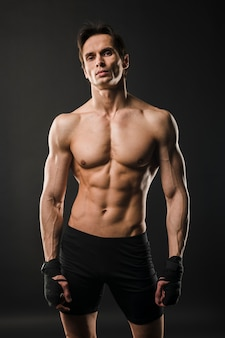 Shirtless muscly man posing