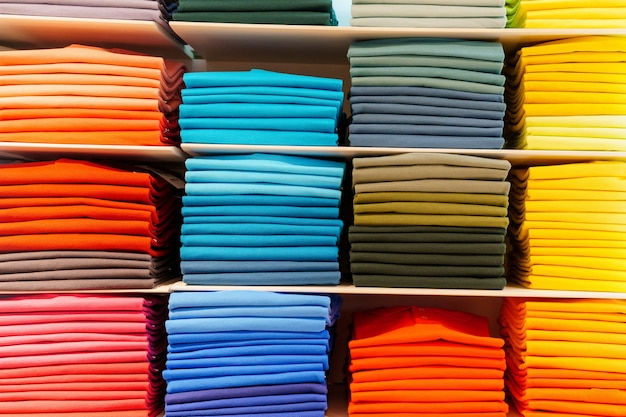 Shirts folded and sorted by colour ranges. market place