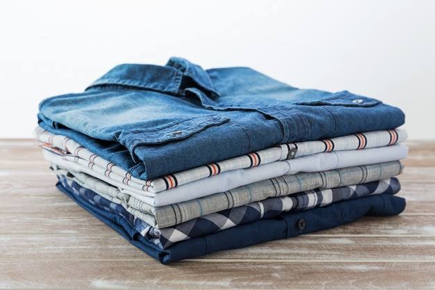 Shirts folded on wooden table