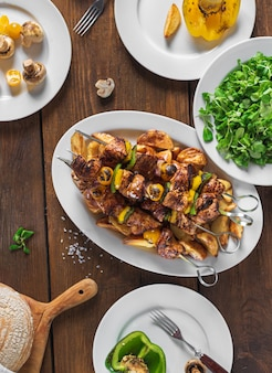 Shish kebab, vegetables and salad