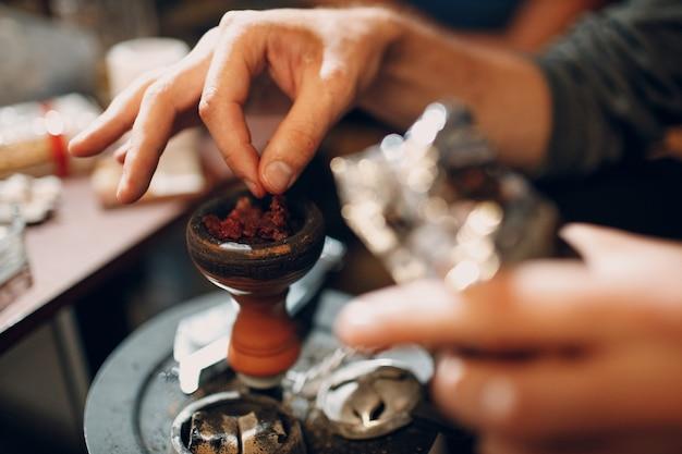 Shisha hookah hot coal and tobacco for smoking and leisure.