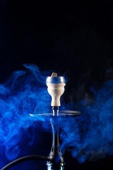 Shisha hookah with hot coals on black background