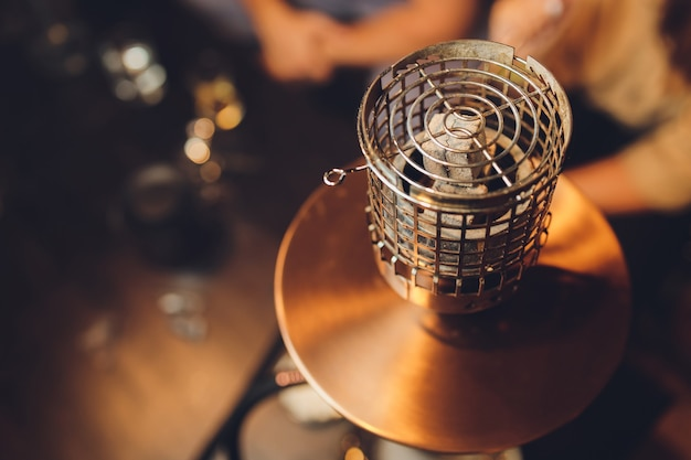 Shisha hookah with red hot coals. sparks from breathe. modern hookah with coconut charcoal and shisha smoke. hookah and sparks from coals.,traditional hookah hot coals for smoking natural lighting.