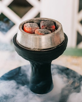 Shisha kiln with fire and steam.