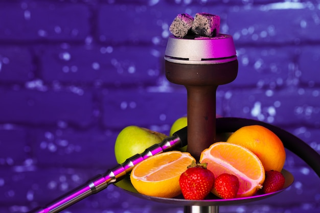 Shisha parts and fresh fruits close up photo