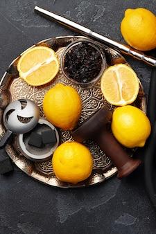 Shisha parts, tobacco and lemons close up photo