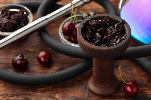 Shisha parts with fresh cherry close up photo