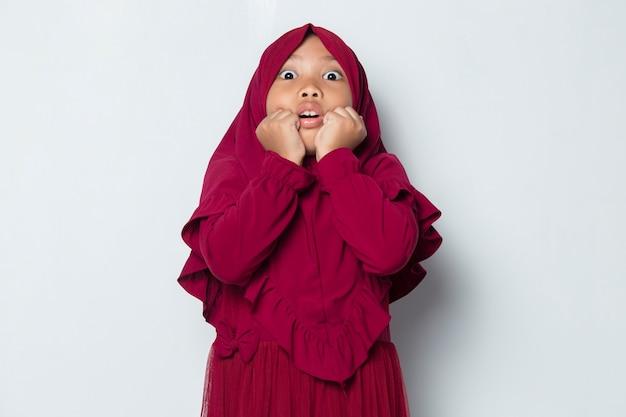 Shock asian muslim little girl feeling surprise isolated on white background