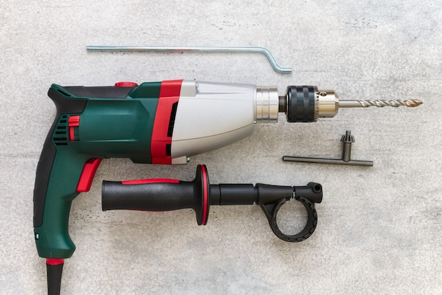 Shock electric drill with additional handle and drill depth limiter