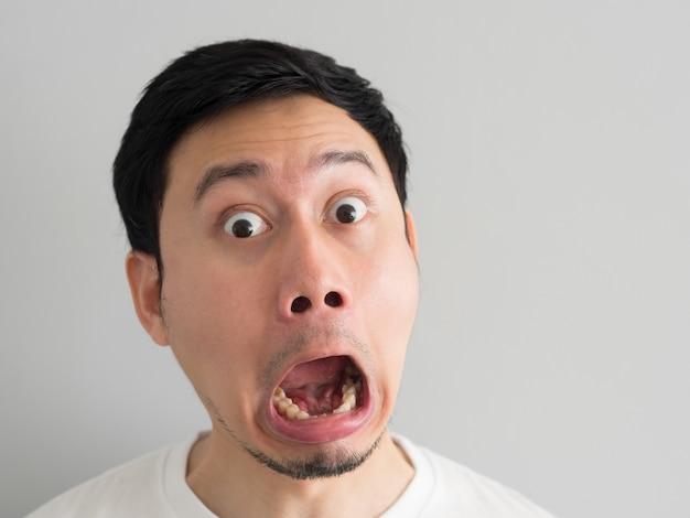 Shock face of asian man head shot.