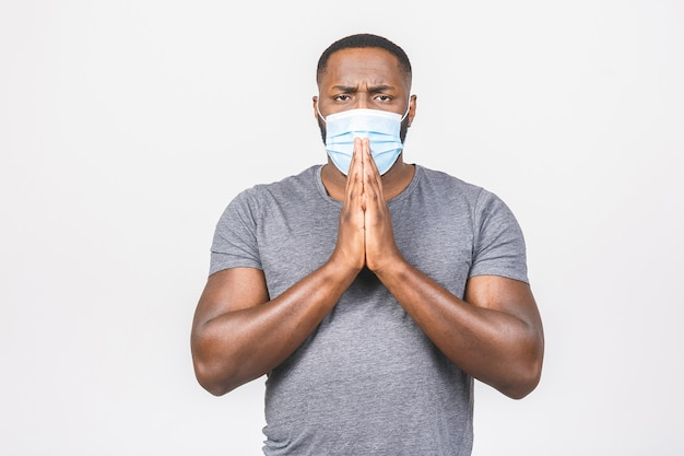 Shocked african american man wearing hygienic mask to prevent infection, airborne respiratory illness Premium Photo