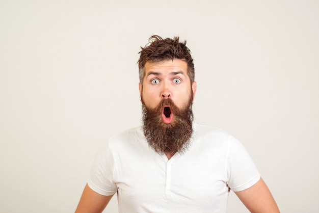 Shocked bearded man with white shirt