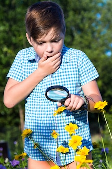 Shocked boy with magnifying glass