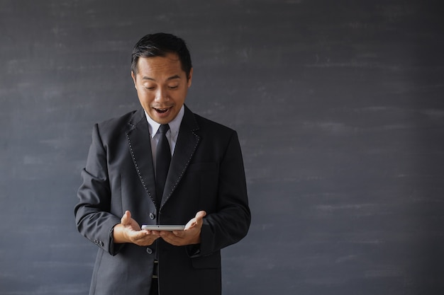 Shocked businessman get surprise from the smart phone