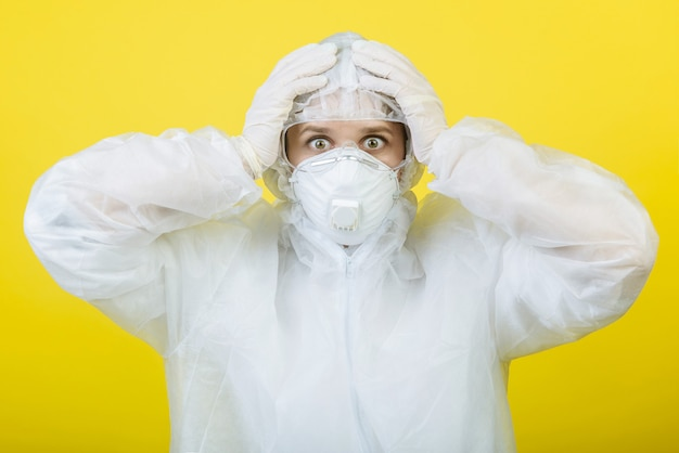 Shocked doctor in protective suit respirator masks isolated. epidemic pandemic Premium Photo