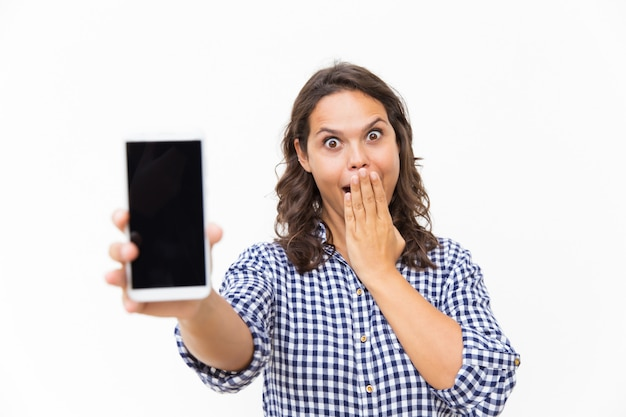 Shocked excited customer showing blank phone screen