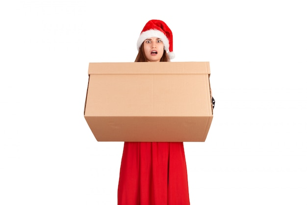 Shocked excited girl standing and holding open big gift carton box. isolated on white background. holidays