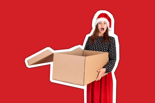Shocked excited girl standing and holding open big gift carton box. magazine collage style