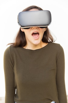 Shocked excited woman in vr headset shouting