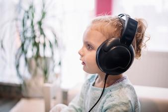 Shocked girl listening to music