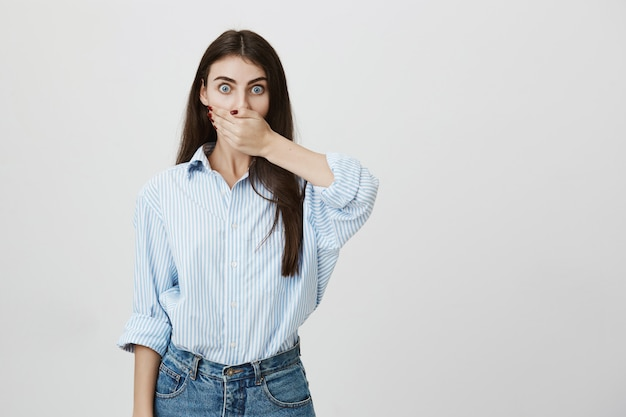 Shocked girl staring and cover mouth with hand