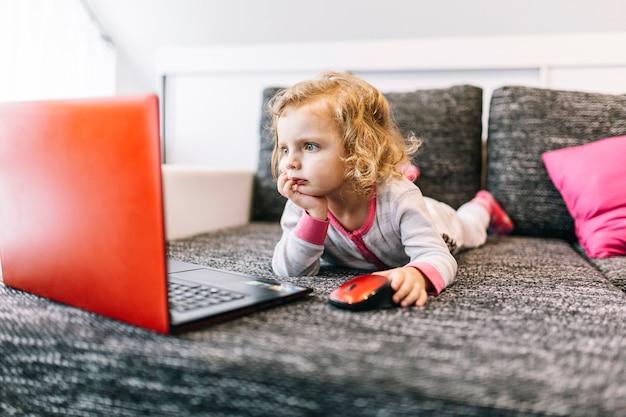 Shocked girl using laptop