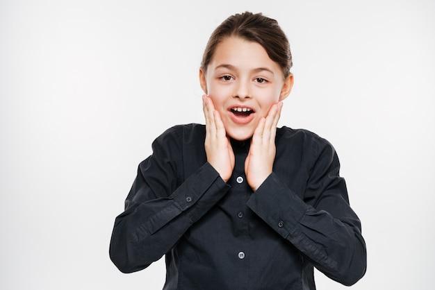Shocked happy young girl posing