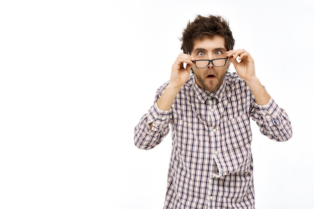 Shocked startled guy take-off glasses