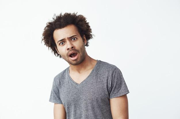 Shocked surprised african man.