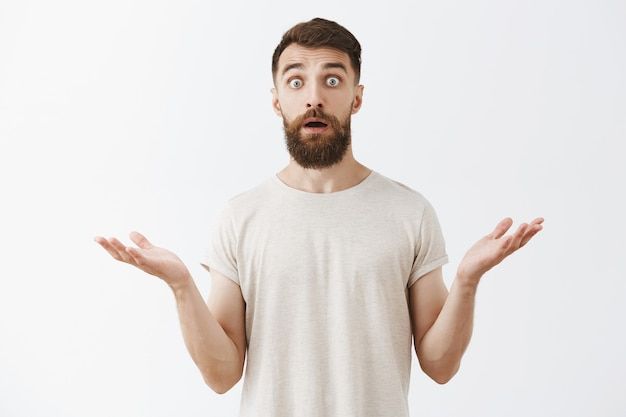Shocked and surprised bearded guy looking astonished