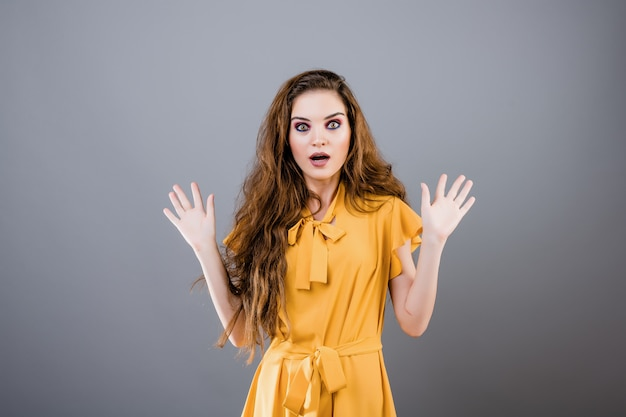 Shocked and surprised young woman isolated